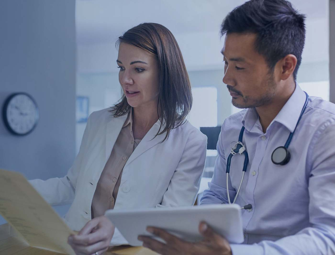 two doctors reviewing charts